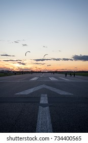 BERLIN, GERMANY - OCTOBER 8, 2017: people enjoying an evening stroll on the runway at the former Tempelhof Airport, now a public park in Berlin.