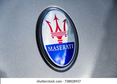 Berlin, Germany - October 8, 2017: The trident logo of the Maserati car company. The logo of the Italian luxury vehicle manufacturer is based on the Fountain of Neptune in Bologna's Piazza Maggiore