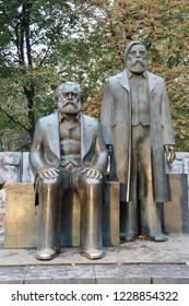 Berlin, Germany - October,2018: Bronze statue of Karl Marx and Friedrich Engels in Marx-Engels-Forum (former DDR). Authors of The Communist Manifesto. Influencal in the Socialist or Communist movement