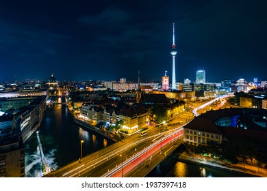 Berlin, Germany, panoramic view of Berlin cityscape and Spree River at night.