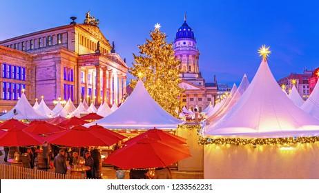 Berlin, Germany, Panoramic view on Christmas Market - Gendarmenmarkt. Xmas Markets is traditional winter holidays activities in Europe. Gendarmenmarkt is most popular Xmas market in Berlin.