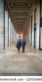 Berlin Germany: people walking through porticos