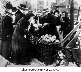 Berlin, Germany, the selling of tin cans in the street, an indication of terible inflation in the economy, 1923