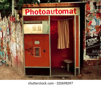 BERLIN, GERMANY - SEP 4: Common attraction in Berlin - Photo Automat - on the dirty street on September 4, 2015. Urban area of Berlin comprised about 4 million people making it 7th most populous in EU