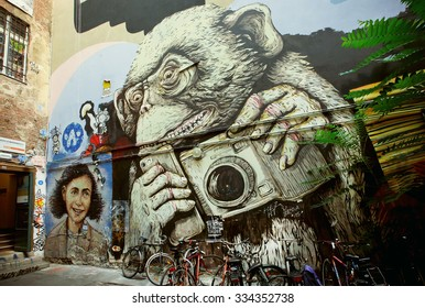 BERLIN, GERMANY - SEPT 2, 2015: Hipster monkey with mobile phone and camera, unknown artist graffiti on Septemper 2, 2015. Urban area of Berlin comprised 4 million people, 7th most populous in EU
