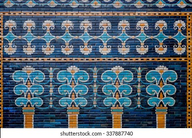 BERLIN, GERMANY - SEPT 2, 2015: Ceramic coating with images of trees and patterns on the historical wall of Babylon on Septemper 2, 2015. Artifact saved by Pergamon Museum in Berlin
