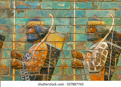 BERLIN, GERMANY - SEPT 2, 2015: Two soldiers of historical empire with bows and spears, ceramic patterned wall of city Babylon on Septemper 2, 2015. Artifact of Iraq saved by Pergamon Museum in Berlin