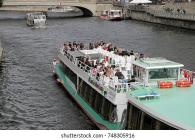 BERLIN, GERMANY - SEPTEMBER 04, 2017: Tourists on boat on a sightseeing city tour through Berlin, Germany.