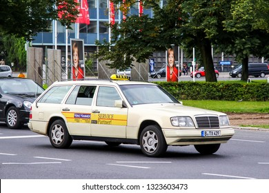 Berlin, Germany - September 10, 2013: Taxi car Mercedes-Benz S124 E-class in the city street.
