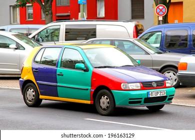 BERLIN, GERMANY - SEPTEMBER 10, 2013: Volkswagen Polo Harlekin retro car at the city street.