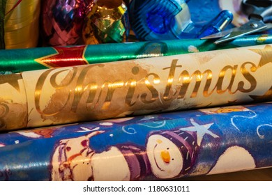 Berlin, Germany - September 11, 2018: Various materials such as scissors, wrapping paper and ribbons to pack and decorate Christmas presents.