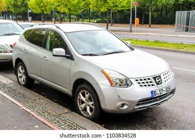 Berlin, Germany - September 12, 2013: Motor car Nissan Rogue in the city street.