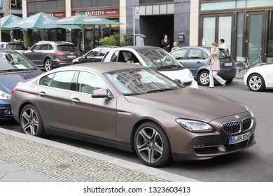 Berlin, Germany - September 12, 2013: Brown sportscar BMW 6-series Gran Coupe (F06) in the city street.