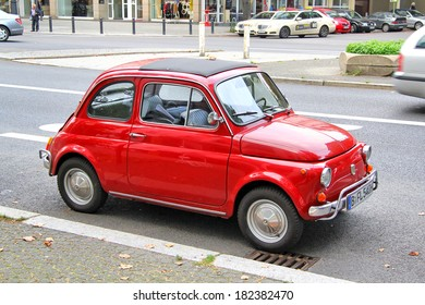 BERLIN, GERMANY - SEPTEMBER 12, 2013: Red Fiat 500 retro car at the city street.