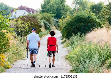 Berlin, Germany - September 12, 2018: Two elder walkers from behind on a footpath in Berlin.