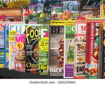 Berlin, Germany - September 13, 2018: Newsstand interior, cover pages of German magazines displayed on a stand for sale