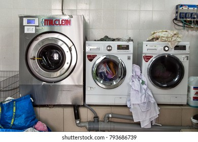 Berlin, Germany - September 14, 2017: Automatic washing machines at laundry service
