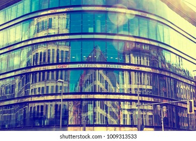 BERLIN, GERMANY - SEPTEMBER 17, 2017: City architecture reflected in glass facade windows of Galeries Lafayette Berlin building. This building of French architect Jean Nouvel also called Quartier 207