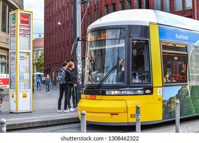 Berlin, Germany - September 17 2018: Two young German men wait to board a Metro Tram near Alexanderplatz in the Mitte district of Berlin Germany.