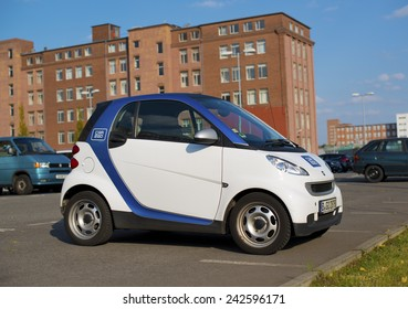 "BERLIN, GERMANY - SEPTEMBER 18: logo of the brand ""Car2Go"" on a smart for carsharing. Berlin, Germany, Europe sept 18 2014"