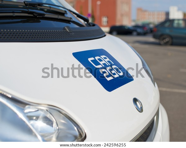 """BERLIN, GERMANY - SEPTEMBER 18: logo of the brand """"Car2Go"""" on a smart for carsharing. Berlin, Germany, Europe sept 18 2014"""