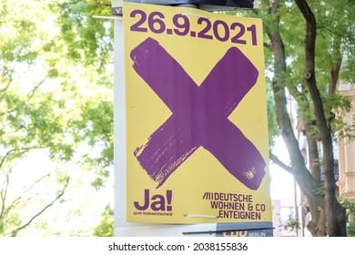 "Berlin, Germany - September 2, 2021: Campaign poster Ja! zum Volksentscheid, German for Yes to the referendum, for the referendum ""Expropriate Deutsche Wohnen and Co."" in August 2021"