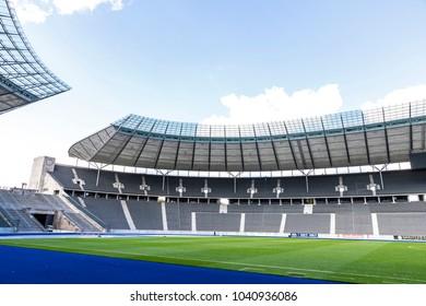 BERLIN, GERMANY - SEPTEMBER 20, 2017: Green grass pitch and empty tribunes of Olympiastadion (Olympic Stadium) in Berlin seen before German Bundesliga game Hertha BSC Berlin v Bayer 04