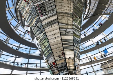 BERLIN, GERMANY - SEPTEMBER 20, 2017: People walking inside the Reichstag Dome. It is a glass dome constructed on the top of the Reichstag (Bundestag) building, designed by architect Norman Foster