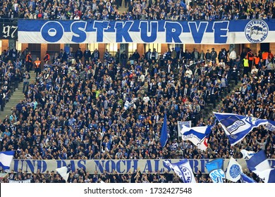 Berlin, Germany - September 20, 2017: Hertha BSC Berlin ultras (ultra supporters) perform on tribunes during the German Bundesliga game against Bayer 04 Leverkusen at Olympiastadion Berlin