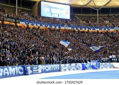 Berlin, Germany - September 20, 2017: Fan tribunes of Olympiastadion in Berlin (Olympic Stadium) crowded with Hertha BSC Berlin ultras seen during German Bundesliga game against Bayer 04 Leverkusen