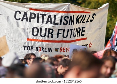 BERLIN, GERMANY - SEPTEMBER 20, 2019: Capitalism kills our future message on a big white banner carried by demonstrators at the Fridays For Future climate change protest at the Brandenburg Gate.