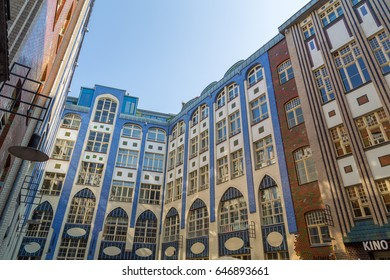 Berlin, Germany - September 2016: Historic facades of Hackesche Hoefe at Hackescher Markt, Berlin on a beautiful day. The buildings were built in 1906 and their colourful facades are a tourist magnet.