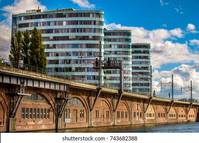 BERLIN, GERMANY - SEPTEMBER 21, 2015: Tour Boat and modern architecture on Spree River in the inner city of Berlin, capital of Germany, Europe