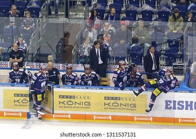 BERLIN, GERMANY - SEPTEMBER 22, 2017: Head Coach Uwe Krupp (C) and players of Eisbaren Berlin team during the Deutsche Eishockey Liga (DEL) game against Kolner Haie at Mercedes-Benz Arena in Berlin