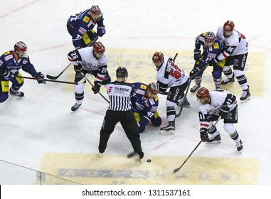 BERLIN, GERMANY - SEPTEMBER 22, 2017: Eisbaren Berlin (in Blue) and Kolner Haie players (in White) fight for a puck during their Deutsche Eishockey Liga (DEL) game at Mercedes-Benz Arena in Berlin
