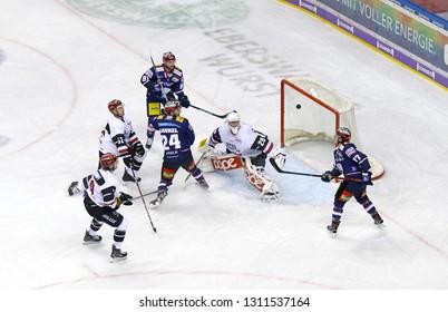BERLIN, GERMANY - SEPTEMBER 22, 2017: Eisbaren Berlin players (in Blue) attack Kolner Haie net during their Deutsche Eishockey Liga (DEL) game at Mercedes-Benz Arena in Berlin. Eisbaren won 3-2