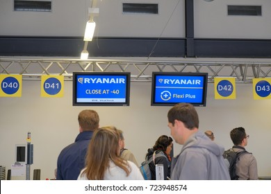 Berlin, Germany - September 22, 2017: Check in at airport. People in a row to board a Ryanair flight