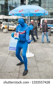Berlin, Germany - September 23rd 2017: An AFD election stand at Berlin's main station. A man in AfD blue offering something.