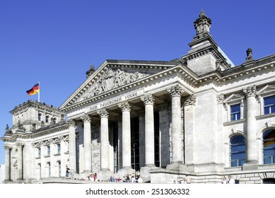 Berlin, Germany - September 24, 2007: Touristen in front of the Reichstag building in Berlin - Seat of the German Parliament.