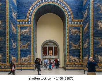 BERLIN, GERMANY - SEPTEMBER 26, 2018: Centralized view of tourists visiting the historical Ishtar Gate of Babylon, made of glazed blue bricks, at the Pergamon Museum, in the Museum Island