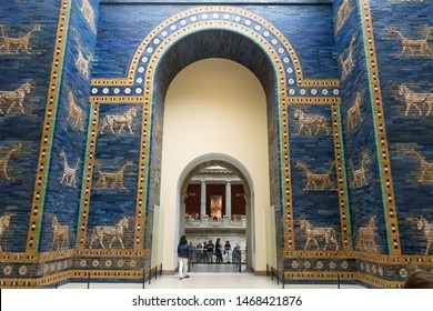 BERLIN, GERMANY - SEPTEMBER 26, 2018: Upwards overview of the blue Ishtar Gate of Babylon, decorated with extinct aurochs and mythological creatures at the Pergamon History Museum, in the Museum