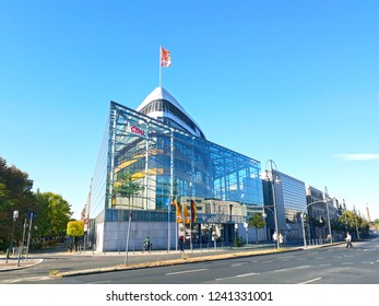 BERLIN, GERMANY - SEPTEMBER 30, 2018: The flag of the German christian democrat party CDU waving on the roof of the party's headquarter Konrad-Adenauer-Haus in Berlin on September 30, 2018.