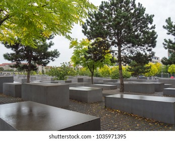 BERLIN /GERMANY - SEPTEMBER 8 2017: Holocaust Memorial (Memorial to the Murdered Jews of Europe) with autumn trees and fallen leaves after rain. Berlin, Germany.