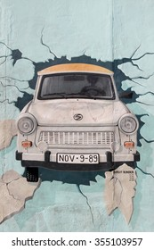 Berlin, Germany - September 9, 2014: Painting from Birgit Kinder of a Trabant in The East Side Gallery, Berlin Wall