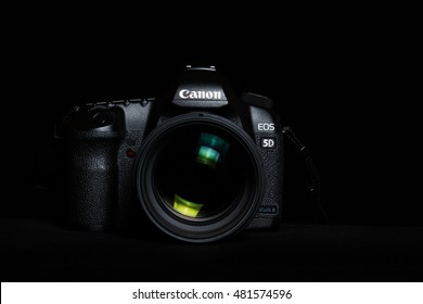 Berlin, Germany  - September 9, 2016: Canon 5D mark 2  interchangeable-lens professional dslr camera on black background,  low key image