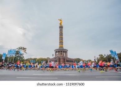 BERLIN, GERMANY - SETEMBER 29, 2019: BMW Berlin Marathon 2019, runners from all over the world during Berlin Marathon 2019, Brandenburg Gate, Alexander Platz, Siegessäule.