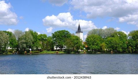 Berlin, Germany, view from Treptower Park over the river Spree to the village church Alt Stralau - Shutterstock ID 2012438963