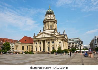Berlin, Germany-07 12 2015:People walking in front of The Französischer Dom, or French Cathedral, on the Gendarmenmarkt in Berlin, which was built by the Huguenots in the early 18th century.