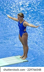 BERLIN, GERMANY-JULY 31, 2002: italian maria marconi on the springboard during a diving race of the European Swimming Championship, in Berlin.