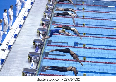 BERLIN, GERMANY-JULY 31, 2002: swimmer on the starter blocks during a swimming race of the European Swimming Championship, in Berlin.